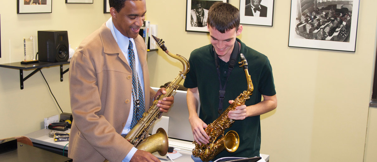 Javon Jackson works with a saxophone student