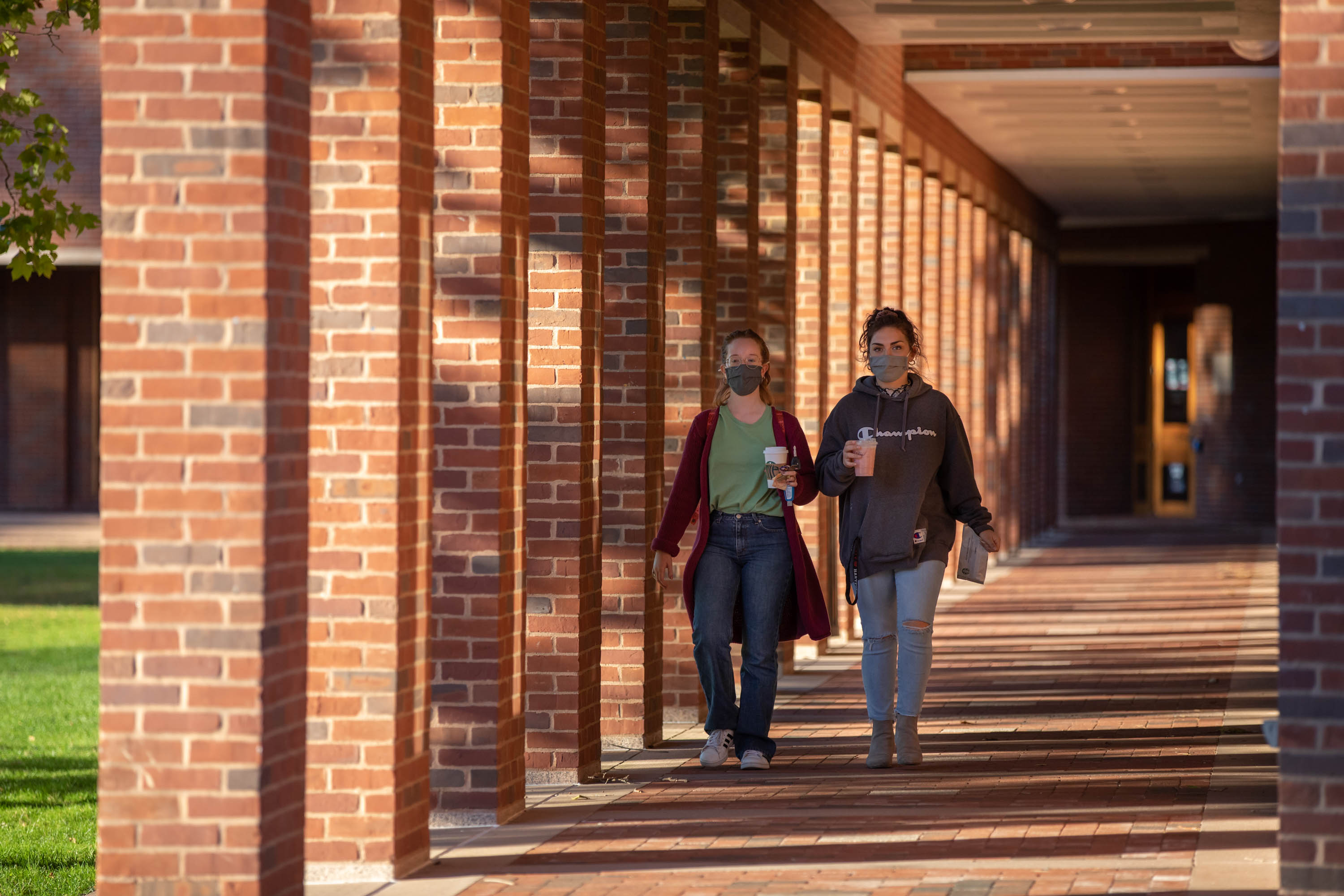 Students walking outside the library